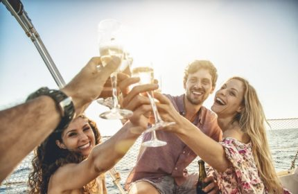 Toasting to summer: sailboat cruise with friends